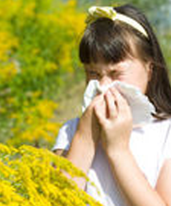 Young girl is blowing her nose